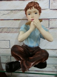 Niño con Armónica
